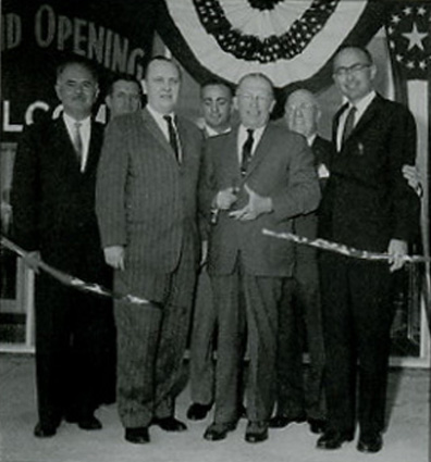 Opening the Cinema Shoppers World, Framingham in 1951 are Phil Smith, Dick Smith, and representatives of the shopping center developer, National Suburban Centers.